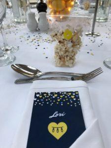 Lori's place card at a wedding reception