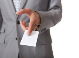 businessman-handing-out-card