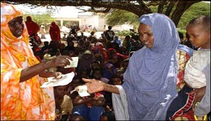 In Ceelasha Biyaha, 20km from Mogadishu, a woman's group distributes aid