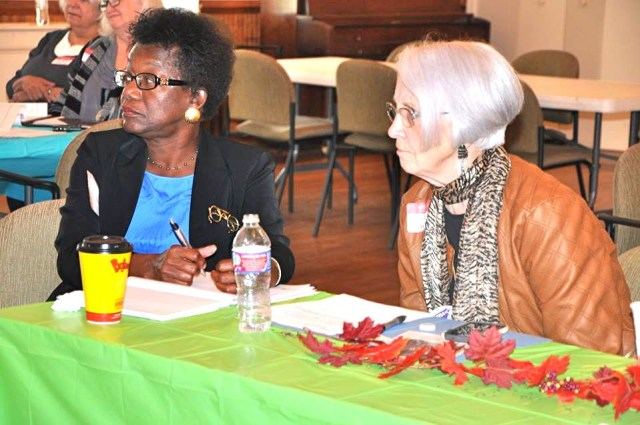 Melinda Lowrance of the NAACP and RATIFY ERA-NC (left) and Lee Luebbe of the League of Women Voters and RATIFY ERA-NC consider strategies.