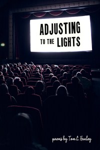 Cover of Adjusting to the Lights, a dark movie theater with the title on a bright white screen
