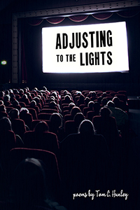 cover of Adjusting to the Lights, a dark movie theater with the title brightly displayed on the screen
