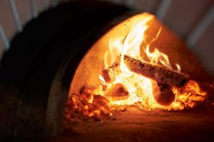 Burning-wood-oven-types-of-oven-featured-image