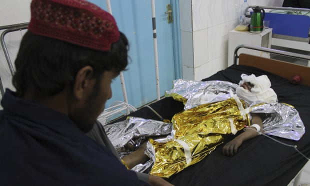 : An injured boy receives treatment at a hospital after an airstrike in Helmand province killed 30 civilians