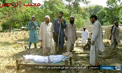 An Islamic State broadcast shows Mohammad Agha conducting a burial for the victims
