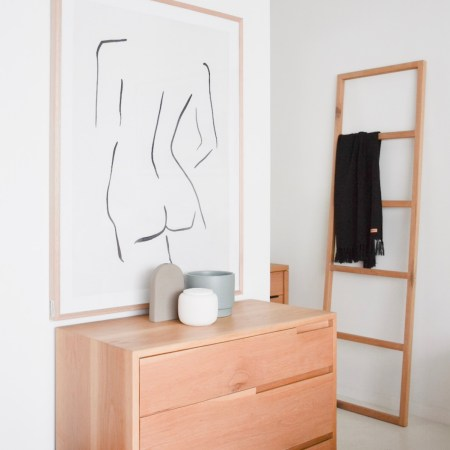 timber chest of drawers in bedroom