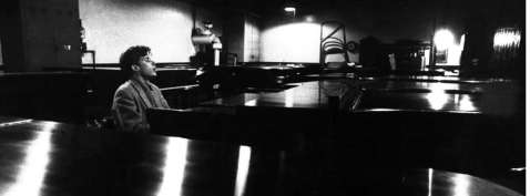 glenn-gould-_singing_-as-he-samples-the-action-tone-of-a-piano-at-the-steinway-warehouse-before-choosing-the-final-one-for-his-e28098bach-goldberg-variations_-r[1]