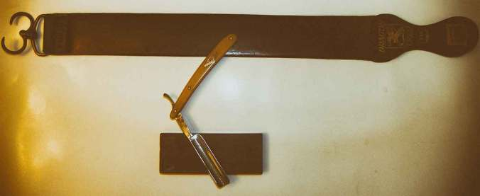 Straight razor. strap (strop) and honing stone