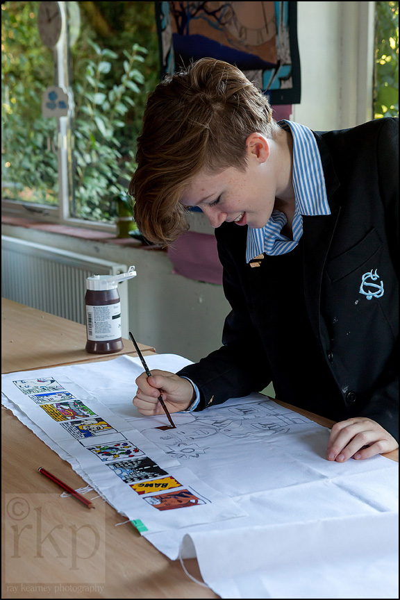 Cransley school art lesson pupil painting on fabric