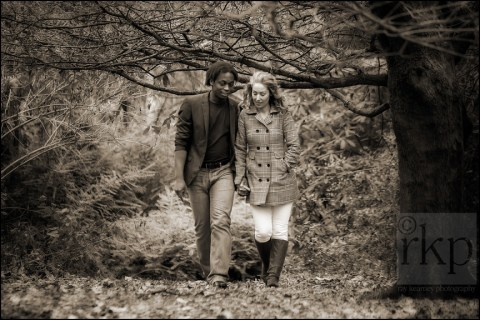 Couple walking through the woods at Denzell Gardens, Altrincham