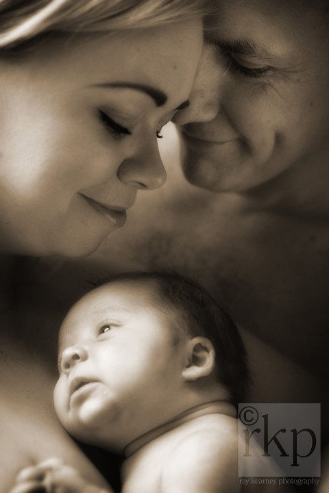 Family close up with newborn baby
