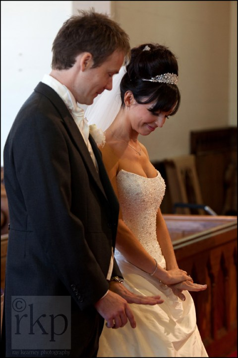 Bride and Groom looking at rings, All Saints church, Thornton Hough