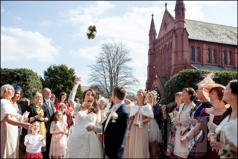 Bride throwing bouquet at St Vincent's, Altrincham