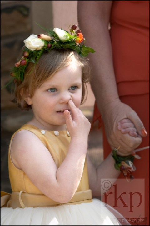 Young Bridesmaid picking her nose