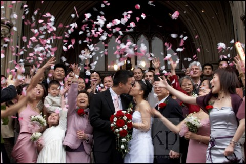 Wedding guests throwing confetti, Manchester Town Hall