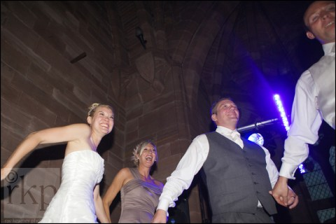 Bride and guests dancing at Peckforton Castle
