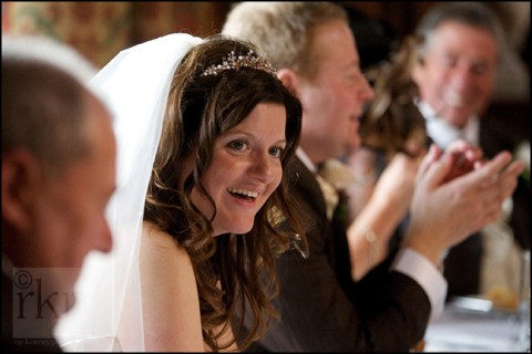 Bride enjoying the speeches at Knowsley Hall