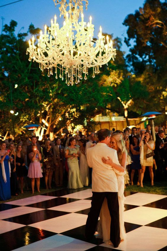 Outdoor black and white dance floor for wedding