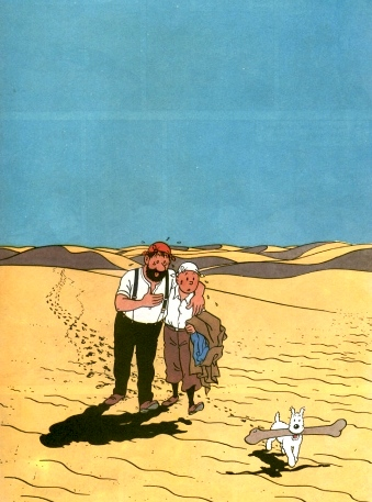 Tintin supports Captain Haddock in the desert