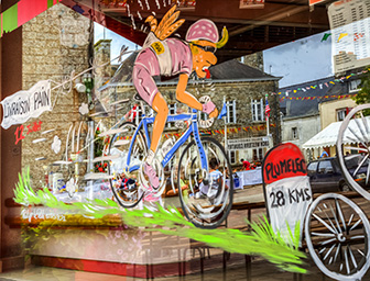 Plumelec, France - 12 July, 2015: Funny window shop decoration in Plumelec during the Team Time Trial stage - Tour de France on 12 July, 2015.