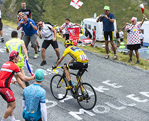 Col du Glandon, France - July 24, 2015: The British cyclist Chris Froome of Team Sky in Yellow Jersey,climbing the road to Col du Glandon in Alps, during the stage 19 of Le Tour de France 2015.