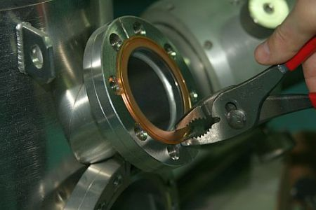 Grip edges of copper gasket