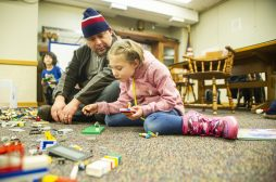 Ron Szymczyk, left, and his daughter, Catherine Szymczyk, 7, of Riverside, build a vehicle together with Legos on Saturday, Jan. 25, 2020, during a LegoPalooza event in the children's section at the Riverside Public Library. | ALEX ROGALS/Staff Photographer