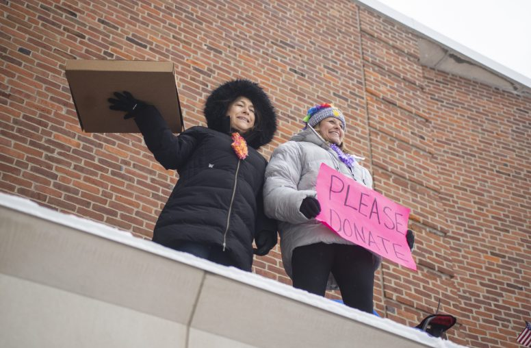 Principal April Mahy and Assistant Principal Christine Mullin cheer on students bringing in food during the first day of the 50th annual food drive at L.J. Hauser Junior High School in Riverside. | ALEX ROGALS/Staff Photographer