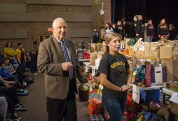 """Cuyler """"Butch"""" Berwanger, left, and seventh-grade science teacher Marella Harrington marvel at all of the donations received on Feb. 26, 2020, during the kickoff of the 50th annual food drive at L.J. Hauser Junior High School in Riverside.