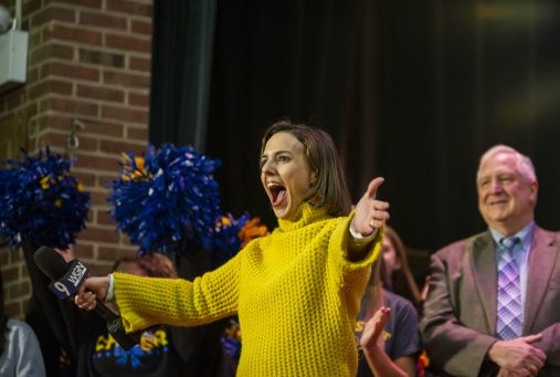 """WGN reporter Ana Belaval during her """"Around Town"""" segment featuring the 50th annual food drive inside the L.J. Hauser Junior High School auditorium on Feb. 26. 