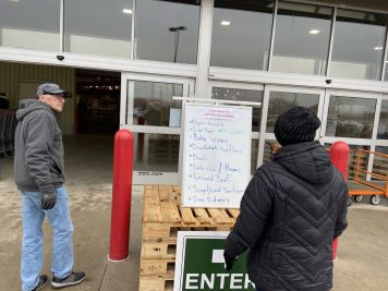 A sign outside Costco in North Riverside on March 16 informs shoppers they're likely to find some items sold out, particularly paper products, cleaning items and bulk food. | Bob Uphues/Staff