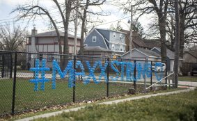"""Blue cups spell out """"#MaxxStrong"""" on the fence around the the football stadium at Riverside-Brookfield High School on April 1. 