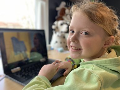 Riverside second-grader Katie Fournier attends class virtually via her laptop computer. | Provided