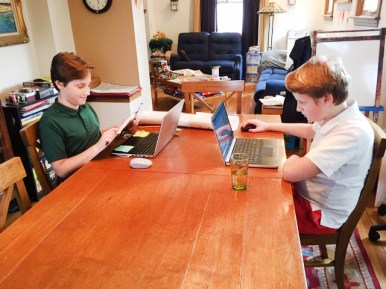 Nick Corradino, left, and his brother Jimmy, both fifth graders at Brook Park School in LaGrange Park, hit the laptops during Phase II of eLearning while schools are closed because of the coronavirus pandemic. | Provided