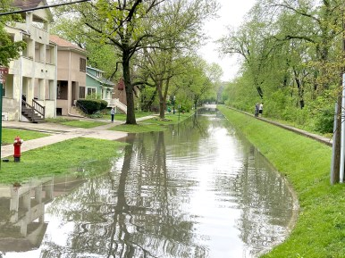 Groveland Avenue residents survey the river level on the morning of May 18 after the street and their properties flooded the night before.(Bob Uphues/Editor)