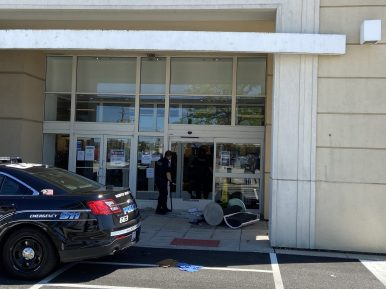 Police guard the north entrance to Kohl's in North Riverside on May 31 after looters broke in by smashing the locked glass doors. | Bob Uphues/Editor