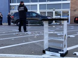 Police stand outside Best Buy in North Riverside on the afternoon of May 31. Looters smashed the glass entry door and then forced open the metal security gate to gain access to the store. | Bob Uphues/Editor
