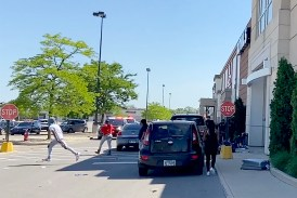 People run from Kohl's, 2200 Cermak Road, after looters broke into both entrances on May 31 and stole merchandise from the store. Looters struck at nearly a dozen North Riverside retailers that afternoon. (Bob Uphues/Editor)