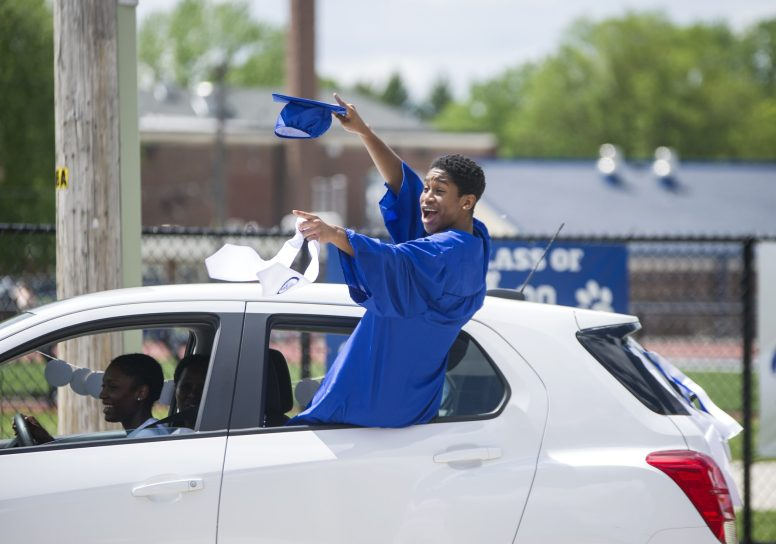 An RB graduate cheers from inside his vehicle after recieving his diploma on Friday, May 29, 2020, during RBHS graduation ceremony outside of the school in Riverside. | ALEX ROGALS/Staff Photographer