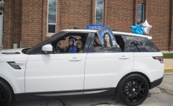 Grads cheer from their cars on Friday, May 29, 2020, during RBHS graduation ceremony outside of the school in Riverside. | ALEX ROGALS/Staff Photographer