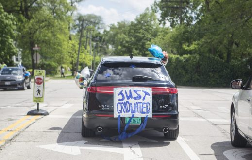 "A vehicle carrying a recent graduate is seen with a ""Just Graduated"" banner on the back bumper on Friday, May 29, 2020, during RBHS graduation ceremony outside of the school in Riverside. 