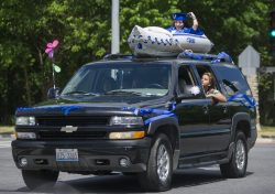 Graduates wave and cheer from their decorated vehicles on Friday, May 29, 2020, during RBHS graduation ceremony outside of the school in Riverside. | ALEX ROGALS/Staff Photographer