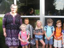 Jenny Barhorst stands for a photo with her first-graders on the first day of school, an annual tradition. She's been at it so long Barhorst had in her classrooms about five students whose parents she also taught at Hollywood School. (Photo provided)