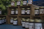 Different types of jams and jellys from Cooper Farms is displayed on Saturday, June 6, 2020, during the opening weekend of the Brookfield Farmers Market outside of Village Hall in Brookfield. (Alex Rogals/Staff Photographer)