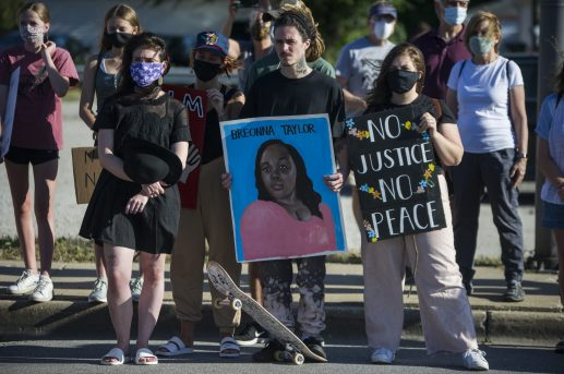 Demonstrators listen to speakers Destiny Richardson and Destiny Hurd at Ogden and Maple at the conclusion of their march through LaGrange and Brookfield on June 11. | Alex Rogals/Staff Photographer