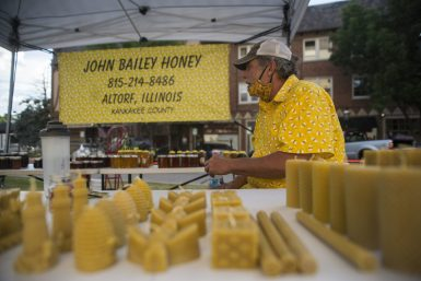 Steve Bohan sits at the John Bailey Honey booth on Wednesday, June 24, 2020, during the Riverside Farmers Market. (Alex Rogals/Staff Photographer)