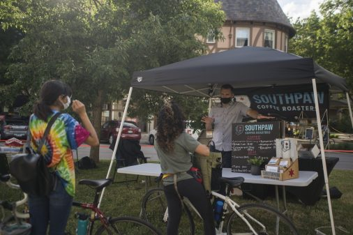 Attendees ask questions about the coffee at Southpaw on Wednesday, June 24, 2020, during the Riverside Farmers Market. (Alex Rogals/Staff Photographer)