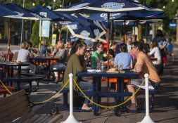 Diners eat at the outdoor dining area for The Chew Chew on Thursday, June 25, 2020, on Burlington Street in Riverside. (Alex Rogals/Staff Photographer)