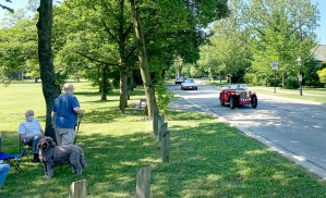 Residents along the parade route got a bonus attraction from Rey Navarro (above, driving his red MG TC) and other classic car enthusiasts who cobbled together an impromptu car parade that also motored through town at the same time as the village's parade. (Bob Uphues/Editor)