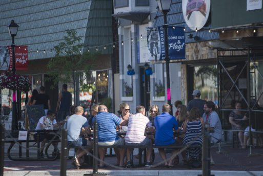 Customers eat and drink outside at the outdoor dining area on July 25, in Brookfield. (Alex Rogals/Staff Photographer)